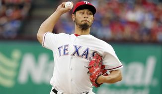 Texas Rangers' Yu Darvish of Japan throws to the Philadelphia Phillies in the first inning of a baseball game, Tuesday, May 16, 2017, in Arlington, Texas. (AP Photo/Tony Gutierrez)