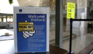 FILE - In this April 6, 2016, file photo, a sign at the federal courthouse in Tacoma, Wash., is shown to inform visitors of the federal government's REAL ID act, which requires state driver's licenses and ID cards to have security enhancements and be issued to people who can prove they're legally in the United States. Washington Gov. Jay Inslee is expected to sign a measure  Tuesday, May 16, 2017, that seeks to bring the state into compliance with federal identification requirements. Just 25 states and the District of Columbia are currently in compliance with the federal law, though most of the remaining states and territories have extensions. (AP Photo/Ted S. Warren, File)