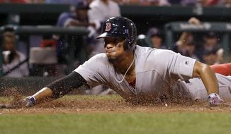 Boston Red Sox's Xander Bogaerts scores during the eighth inning of the team's baseball game against the St. Louis Cardinals on Tuesday, May 16, 2017, in St. Louis. (AP Photo/Jeff Roberson)