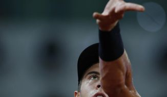 Borna Coric from Croatia serves the ball to Dominic Thiem from Austria during a Madrid Open tennis tournament match in Madrid, Spain, Friday, May 12, 2017. (AP Photo/Francisco Seco)