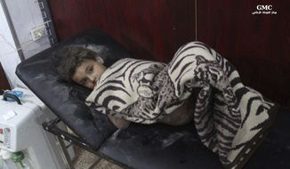 This photo provided by the Syrian anti-government activist group Ghouta Media Center, which has been authenticated based on its contents and other AP reporting, shows a Syrian boy who was wounded by Syrian government forces shelling, at a makeshift hospital, in the Hamouriyya neighborhood, an eastern suburb of Damascus, Syria, Tuesday, May 16, 2017. Syrian activists say a number of rockets struck the opposition-controlled suburb, killing several people. (Ghouta Media Center via AP)