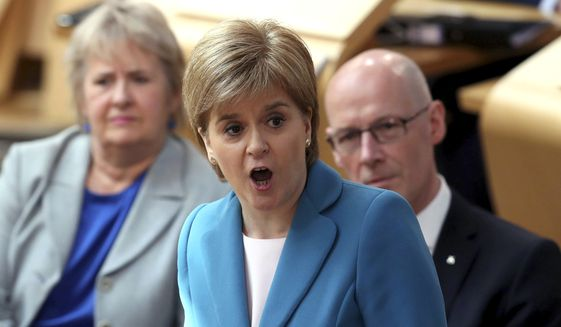 Scotland's First Minister Nicola Sturgeon talks, during First Minister's Questions at the Scottish Parliament in Edinburgh, Thursday May 11, 2017. Britain will hold a general election on June 8. (Jane Barlow/PA via AP)