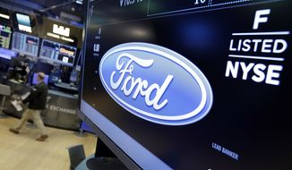 In this Tuesday, May 16, 2017, photo, the logo for the Ford Motor Company appears above a post on the floor of the New York Stock Exchange. Ford Motor Co. said Wednesday, May 17,  it plans to cut 10 percent of its salaried jobs in North America and Asia Pacific this year in an effort to boost profits. (AP Photo/Richard Drew)