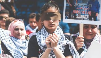 Protesters in Ramallah support the hunger strike launched by Palestinian prisoners and their jailed leader Marwan Barghouti. (Reham Abdelrahman)