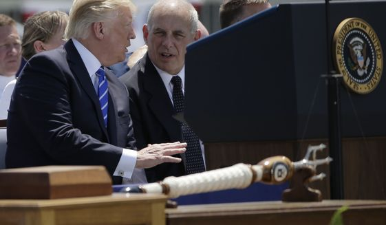 President Donald Trump, left, speaks with Homeland Security Secretary John Kelly, right, during commencement exercises for the U.S. Coast Guard Academy, Wednesday, May 17, 2017, in New London, Conn. (AP Photo//Steven Senne)