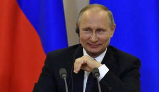 """Russian President Vladimir Putin listens to a question at a joint news conference with Italian Prime Minister Paolo Gentiloni at the Bocharov Ruchei state residence in Russian Black Sea resort of Sochi on Wednesday, May 17, 2017. Russian President Vladimir Putin has dismissed the ongoing scandal around U.S President Donald Trump sharing classified intelligence with Russian officials as """"political schizophrenia."""" (Yuri Kadobnov/ Pool photo via AP)"""