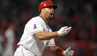 Los Angeles Angels' Albert Pujols reacts as he hits a game-winning RBI single during the 11th inning of a baseball game against the Chicago White Sox, Tuesday, May 16, 2017, in Anaheim, Calif. (AP Photo/Mark J. Terrill)