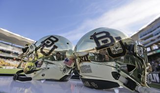 FILE - In this Dec. 5, 2015, file photo, Baylor helmets on shown the field after an NCAA college football game in Waco, Texas. A new federal lawsuit against Baylor University alleges football players routinely recorded gang rapes and staged dogfights in a program that fostered sexual violence. A former Baylor volleyball player identified only as Jane Doe filed the lawsuit Wednesday, May 17, 2017. (AP Photo/LM Otero, File)