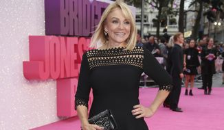 """FILE- In this Sept. 5, 2016, file photo, screenwriter Helen Fielding poses for photographers upon arrival at the World premiere of the film """"Bridget Jones's Baby"""" in London. Fielding's latest book """"Bridget Jones's Baby: The Diaries"""" was declared winner of the Bollinger Everyman Wodehouse Prize for comic fiction on Thursday, May 18, 2017. (Photo by Joel Ryan/Invision/AP, File)"""