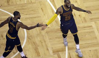 Cleveland Cavaliers center Tristan Thompson, celebrates with forward LeBron James after a basket during the second quarter of Game 1 of the NBA basketball Eastern Conference finals against the Boston Cetlics, Wednesday, May 17, 2017, in Boston. (AP Photo/Charles Krupa)