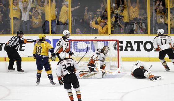 Fans celebrate after a shot by Predators defenseman Roman Josi, of Switzerland, not shown, got past Anaheim Ducks goalie John Gibson (36) for the winning goal during the third period in Game 3 of the Western Conference final in the NHL hockey Stanley Cup playoffs Tuesday, May 16, 2017, in Nashville, Tenn. Also defending for the Ducks are Sami Vatanen (45), of Finland; Jakob Silfverberg (33), of Sweden; Cam Fowler (4) and Ryan Kesler (17). The Predators won 2-1 and lead the series 2-1. (AP Photo/Mark Humphrey)