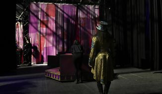 """Kristen Michelle Wilson, the first female ringmaster for the Ringling Bros. and Barnum & Bailey circus, stands backstage as she prepares to open the show, Friday, May 5, 2017, in Providence, R.I. """"The Greatest Show on Earth"""" is about to put on its last show on earth. For the performers who travel with the Ringling Bros. and Barnum & Bailey Circus, its demise means the end of a unique way of life for hundreds of performers and crew members. (AP Photo/Julie Jacobson)"""