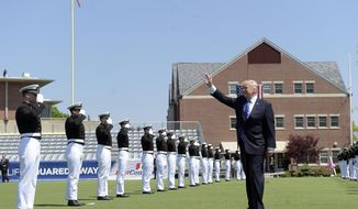 President Donald Trump waves as he arrives to give the commencement address at the U.S. Coast Guard Academy, Wednesday, May 17, 2017, in New London, Conn. (AP Photo/Susan Walsh)