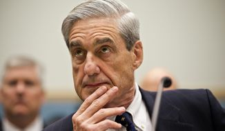In this June 13, 2012, file photo, then-FBI Director Robert Mueller listens as he testifies on Capitol Hill in Washington. (AP Photo/J. Scott Applewhite, File)