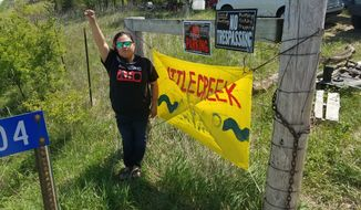 Vanessa Dundon, who goes by Sioux Z Dezbah, moved to the Little Creek Camp in Iowa after months of activism at the North Dakota pipeline protest. She was injured at the bridge standoff in November. (Valerie Richardson/The washington Times)