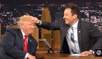 """Jimmy Fallon of """"The Tonight Show"""" messes up the hair of Republican presidential candidate Donald Trump during a September 2016 show. (YouTube, The Tonight Show) ** FILE **"""