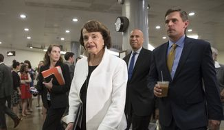From left, Sen. Dianne Feinstein, D-Calif., ranking member on the Senate Judiciary Committee, Sen. Cory A. Booker, D-N.J., and Sen. Martin Heinrich, D-N.M., walk on Capitol Hill in Washington, Thursday, May 18, 2017, to meet with Deputy Attorney General Rod Rosenstein for a briefing of the full Senate amid controversy over President Donald Trump's firing of FBI Director James Comey. (AP Photo/J. Scott Applewhite)