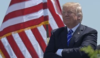 President Donald Trump attends commencement exercises at the U.S. Coast Guard Academy in New London, Conn., Wednesday, May 17, 2017, where he also gave the commencement address. (AP Photo/Susan Walsh)
