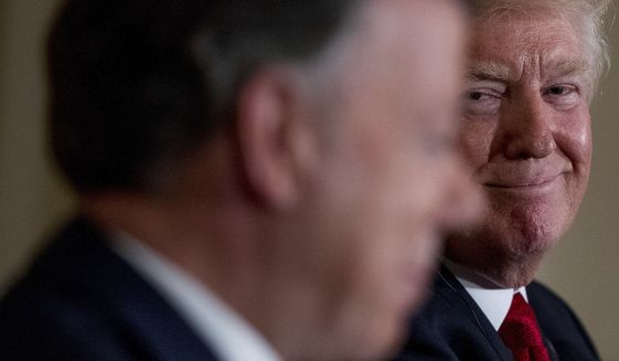 President Donald Trump smiles as he listens to Colombian President Juan Manuel Santos, speak during a news conference in the East Room of the White House, Thursday, May 18, 2017, in Washington. (AP Photo/Andrew Harnik)