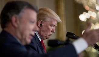 President Donald Trump listens to Colombian President Juan Manuel Santos, left, speak during a news conference in the East Room of the White House, Thursday, May 18, 2017, in Washington. (AP Photo/Andrew Harnik)