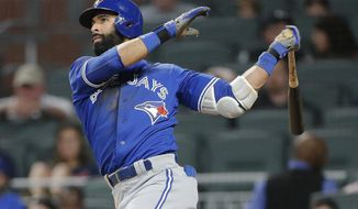 Toronto Blue Jays' Jose Bautista (19) follows through on a solo home run during the eighth inning against the Atlanta Braves in a baseball game Wednesday, May 17, 2017, in Atlanta. Atlanta won 8-4. (AP Photo/John Bazemore)