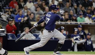 Milwaukee Brewers' Jett Bandy watches his RBI single during the ninth inning of the team's baseball game against the San Diego Padres on Wednesday, May 17, 2017, in San Diego. (AP Photo/Gregory Bull)