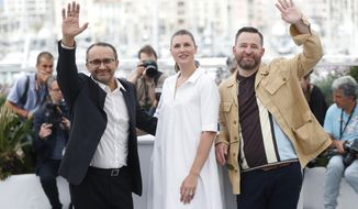 From left, director Andrey Zvyagintsev, actors Maryana Spikav and Alexei Rozin pose for photographers during the photo call for the film Loveless at the 70th international film festival, Cannes, southern France, Thursday, May 18, 2017. (AP Photo/Thibault Camus)