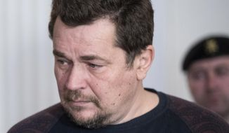 Suspected Lithuanian hacker Evaldas Rimasauskas is seen before a court session in Vilnius, Lithuania, Thursday, May 18, 2017. A court in Lithuania wants more information from the United States before ruling on the extradition of a local businessman suspected of conning Google and Facebook out of more than 100 million dollars. (AP Photo/Mindaugas Kulbis)