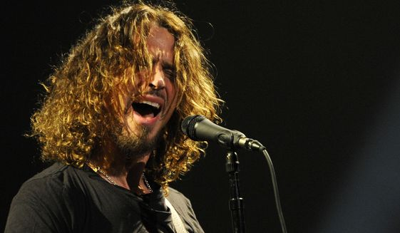 Chris Cornell of Soundgarden performs during the band's concert at the Wiltern in Los Angeles, in this Feb. 13, 2013 file photo. Mr. Cornell, 52, who gained fame as the lead singer of the bands Soundgarden and Audioslave, died at a hotel in Detroit and police said Thursday, May 18, 2017, that his death is being investigated as a possible suicide. (Photo by Chris Pizzello/Invision/AP) ** FILE **