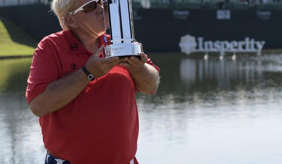 FILE - In this May 7, 2017, file photo, John Daly kisses the trophy after winning the PGA Tour Champions Insperity Invitational golf tournament in The Woodlands, Texas. Fresh from his first PGA Tour Champions victory, Daly enters the year's first major seeking a strong follow-up at the Regions Tradition. (Wilf Thorne/Houston Chronicle via AP, File)