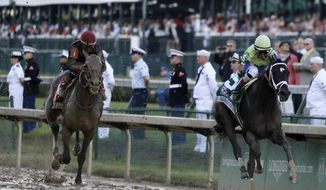 FILE - In this May 6, 2017, file photo, John Velazquez rides Always Dreaming, right, to victory in the Kentucky Derby horse race at Churchill Downs in Louisville, Ky. At left is Lookin at Lee, with jockey Corey Lanerie. Finishing second in the Derby seemingly impressed no one. Lookin At Lee has received very little attention at Pimlico this week and is a 10-1 underdog in the Preakness. Always Dreaming is the 4-5 favorite, despite beating Lookin at Lee by a mere 2 3/4 lengths at Churchill Downs. (AP Photo/Garry Jones, File)