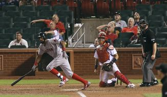 Boston Red Sox's Chris Young drives in the go-ahed run with a single in the 13th inning against the St. Louis Cardinals in a baseball game Wednesday, May 17, 2017, at Busch Stadium in St. Louis. The Red Sox won 5-4. (Chris Lee/St. Louis Post-Dispatch via AP)