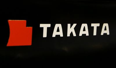 FILE - This July 6, 2016, file photo, shows the logo of Takata Corp. at an auto supply shop in Tokyo. On Thursday, May 18, 2017, Toyota, Subaru, Mazda and BMW reached a proposed settlement that would compensate owners of 15.8 million vehicles for economic losses stemming from the massive recall of Takata air bags. (AP Photo/Shizuo Kambayashi, File)