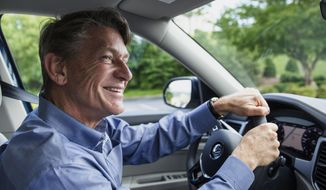 Republican gubernatorial candidate Randy Boyd drives in Chattanooga, Tenn., Thursday, May 18, 2017, after taking the first delivery of Volkswagen's new Atlas SUV. Boyd put a deposit down for the new SUV when he was the state's economic development commissioner in 2015. (AP Photo/Erik Schelzig)