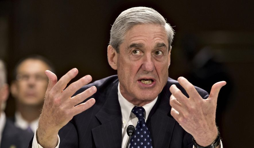 In this June 19, 2013, file photo, former FBI Director Robert Mueller testifies on Capitol Hill in Washington. Mueller was appointed in the spring of 2017 as special counsel to oversee investigation into Russian interference in the 2016 presidential election. (Associated Press) **FILE**