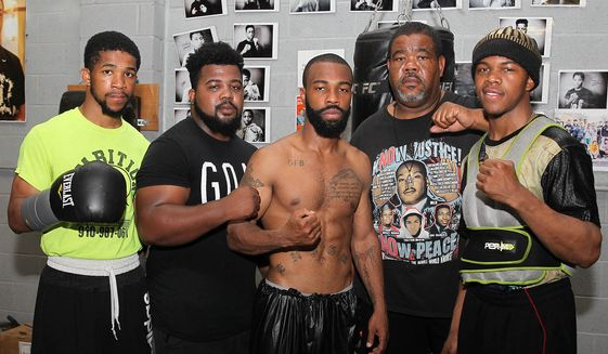 From left to right: Gary Antonio Russell, Gary Allen Russell, Gary Russell Jr., Gary Russell Sr. and Gary Antuanne Russell pose after a media workout in Feburary. (Photo courtesy of Ed Diller/Showtime)