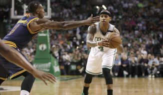 Boston Celtics guard Isaiah Thomas (4) looks to pass the ball as Cleveland Cavaliers guard Iman Shumpert (4) defends during the first half of Game 2 of the NBA basketball Eastern Conference finals, Friday, May 19, 2017, in Boston. Thomas did not return in the second half due to a strained right hip. (AP Photo/Elise Amendola) **FILE**