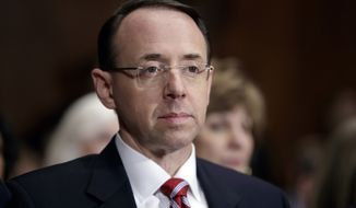 FILE- In this March 7, 2017, file photo, then-Deputy Attorney General-designate Rod Rosenstein, listens on Capitol Hill in Washington, during his confirmation hearing before the Senate Judiciary Committee. Rosenstein has told members of Congress he stands by a memo he wrote that preceded the president's firing of FBI Director James Comey. (AP Photo/J. Scott Applewhite, File)