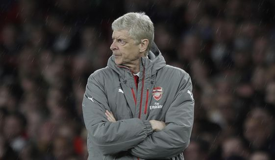 Arsenal's French manager Arsene Wenger folds his arms when the score was 0-0 during the English Premier League soccer match between Arsenal and Sunderland at the Emirates Stadium in London, Tuesday, May 16, 2017. (AP Photo/Matt Dunham)