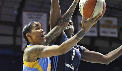 Chicago Sky forward Tamera Young, left, is fouled by Atlanta Dream center Elizabeth Williams during the first half of a WNBA basketball game Friday, May 19, 2017, in Rosemont, Ill. (Patrick Gorski/Chicago Tribune via AP)/Chicago Tribune via AP)