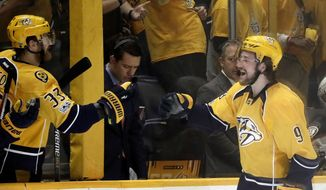 Nashville Predators left wing Filip Forsberg (9), of Sweden, is greeted at the bench by left wing Colin Wilson (33) after Forsberg's game tying goal in the third period of Game 4 of the Western Conference final against the Anaheim Ducks in the NHL hockey Stanley Cup playoffs Thursday, May 18, 2017, in Nashville, Tenn. (AP Photo/Mark Humphrey)