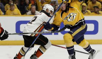 Anaheim Ducks defenseman Kevin Bieksa (2) battles against Nashville Predators center Ryan Johansen (92) in the second period of Game 4 of the Western Conference final in the NHL hockey Stanley Cup playoffs Thursday, May 18, 2017, in Nashville, Tenn. (AP Photo/Mark Humphrey)