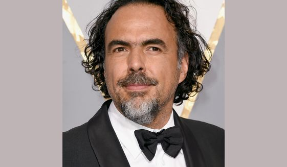 FILE - In this Feb. 28, 2016 file photo, Alejandro Gonzalez Inarritu arrives at the Oscars at the Dolby Theatre in Los Angeles. (Photo by Dan Steinberg/Invision/AP, File)