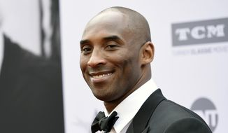 In this June 9, 2016, file photo, retired NBA basketball player Kobe Bryant poses at the 2016 AFI Life Achievement Award Gala Tribute to John Williams in Los Angeles. Bryant came through with an assist for some high school students in Indiana by retweeting one student's request on May 18, 2017, to get them out of a final exam. (Photo by Chris Pizzello/Invision/AP, File)
