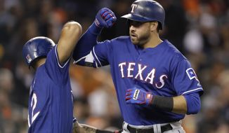 Texas Rangers' Joey Gallo is greeted by Rougned Odor after hitting a two-run home run during the sixth inning of a baseball game against the Detroit Tigers, Friday, May 19, 2017, in Detroit. (AP Photo/Carlos Osorio)