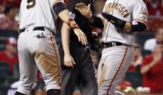 San Francisco Giants' Brandon Crawford, right, and Brandon Belt celebrate after scoring on a double by Eduardo Nunez during the ninth inning of a baseball game against the St. Louis Cardinals on Friday, May 19, 2017, in St. Louis. (AP Photo/Jeff Roberson)