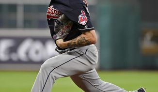 Cleveland Indians starting pitcher Mike Clevinger delivers during the first inning of a baseball game against the Houston Astros, Saturday, May 20, 2017, in Houston. (AP Photo/Eric Christian Smith)