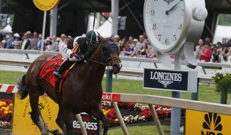 Recruiting Ready with Horacio Karamanos aboard wins the Chick Lang Stakes race ahead of the running of the Preakness Stakes horse race at Pimlico race course, Saturday, May 20, 2017, in Baltimore. (AP Photo/Garry Jones)