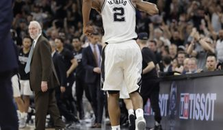 FILE - In this Tuesday, May 9, 2017, file photo, San Antonio Spurs forward Kawhi Leonard (2) limps off the court during the second half of Game 5 in a second-round NBA basketball playoff series against the Houston Rockets in San Antonio. Leonard will not play against Golden State in Game 3 of the Western Conference Finals on Saturday, May 20, 2017, due to a sprained left ankle. (AP Photo/Eric Gay, File)