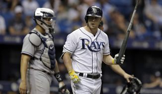 Tampa Bay Rays' Corey Dickerson holds his bat after being hit with a pitch from New York Yankees' Tommy Layne during the fifth inning of a baseball game, Saturday, May 20, 2017, in St. Petersburg, Fla. Catching for the Yankees is Gary Sanchez. (AP Photo/Chris O'Meara)